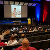 People listen to Coral Briseño speak during a candlelight vigil for Marine Cpl. Humberto Sanchez at McHale Performing Arts Center in Logansport on Wednesday, Sept. 22, 2021.