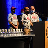 Members of Team Rubicon talk about donating to the Afghan refugees during a candlelight vigil for Marine Cpl. Humberto Sanchez at McHale Performing Arts Center in Logansport on Wednesday, Sept. 22, 2021.