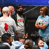 Coral Briseño, right, the mother of Cpl. Humberto Sanchez, speaks with members of Team Rubicon, who helped organize the donations for Afghan refugees staying at Camp Atterbury, during a candlelight vigil for her son at McHale Performing Arts Center in Logansport on Wednesday, Sept. 22, 2021.