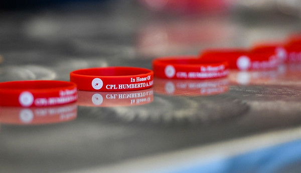 Wristbands lay on a table during a candlelight vigil for Marine Cpl. Humberto Sanchez at McHale Performing Arts Center in Logansport on Wednesday, Sept. 22, 2021.