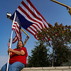 Teresa Cagle of Peru waits for the homecoming procession for Marine Corps Cpl. Humberto Sanchez in Logansport on Sunday, Sept. 12, 2021.  Cagle said her father and stepfather were 20 year vets and she was here to represent them.