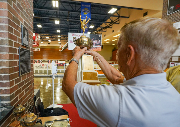 Mike Maple looks for his name on the 1958 North Central Conference trophy at Logansport High School on Monday, Oct. 11, 2021.