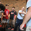 Mike Maple shakes the hand of Logansport Berries coach Mike Johnson while speaking with some of the team in the weight room at Logansport High School on Monday, Oct. 11, 2021. Maple was an All-American football player while at Logansport.
