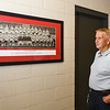 Mike Maple looks at the 1959 Logansport Berries football team photo, which he was a part of, that hangs in the lower part of the Berry Bowl at Logansport High School on Monday, Oct. 11, 2021. The team won the conference that year.