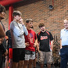 Mike Maple stands next to members of the Logansport football team at Logansport High School in Logansport on Monday, Oct. 11, 2021.