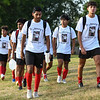 Logansport Berries players walk to warm-ups wearing shorts honoring Marine Corps Cpl. Humberto Sanchez before a game between the Logansport Berries and Lafayette Jeff Bronchos at Logansport High School on Thursday, Sept. 2, 2021.