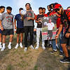Former teammates of Cpl. Humberto Sanchez pose with his senior banner before a game between the Logansport Berries and Lafayette Jeff Bronchos at Logansport High School on Thursday, Sept. 2, 2021.