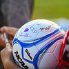 A ball is signed by former teammates of Cpl. Humberto Sanchez before a game between the Logansport Berries and Lafayette Jeff Bronchos at Logansport High School on Thursday, Sept. 2, 2021.