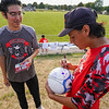 Jose Martinez, a former soccer teammate of Cpl. Humberto Sanchez, signs a ball to give to his family before a game between the Logansport Berries and Lafayette Jeff Bronchos at Logansport High School on Thursday, Sept. 2, 2021.