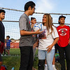 Adrian Gazcon gives Coral Briseño a ball signed by him and others before a game between the Logansport Berries and Lafayette Jeff Bronchos at Logansport High School on Thursday, Sept. 2, 2021.
