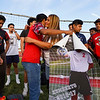 Coral Briseño hugs former teammates of her son Cpl. Humberto Sanchez before a game between the Logansport Berries and Lafayette Jeff Bronchos at Logansport High School on Thursday, Sept. 2, 2021.