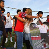 Coral Briseño hugs a former teammate of her son Cpl. Humberto Sanchez before a game between the Logansport Berries and Lafayette Jeff Bronchos at Logansport High School on Thursday, Sept. 2, 2021.