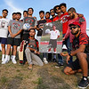 Members fo the 2016 Logansport Berries soccer team pose with Cpl. Humberto Sanchez's senior banner and a ball signed by them for Sanchez's family before a game between the Logansport Berries and Lafayette Jeff Bronchos at Logansport High School on Thursday, Sept. 2, 2021.