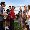 Former teammates of Cpl. Humberto Sanchez talk with his mom Coral Briseño before a game between the Logansport Berries and Lafayette Jeff Bronchos at Logansport High School on Thursday, Sept. 2, 2021.
