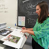 Logansport art teacher Amy Werner explains a bit about the mural she's sketching to honor Cpl. Humberto Sanchez on Tuesday, Aug. 31, 2021.
