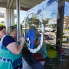 Jane Williams of the Logansport Art Association paints a portion of the mural to honor Cpl. Humberto Sanchez at McDonald's, 611 W. Market St., in Logansport on Wednesday, Sept. 1, 2021. Williams, a retired teacher, taught Sanchez.