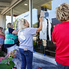 From right: Dawn McAllister, Marta Smiley, Jane Williams and Ali Williams work on the mural of Cpl. Humberto Sanchez at McDonald's, 611 W. Market St., in Logansport on Wednesday, Sept. 1, 2021. Sanchez worked at the eatery while in high school.