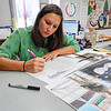 Logansport art teacher Amy Werner sketches out a mural honoring Cpl. Humberto Sanchez in her classroom at Logansport High School on Tuesday, Aug. 31, 2021. The mural will be painted by students.
