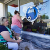 Ali Williams, right, works on the mural for Cpl. Humberto Sanchez with her mom Jane at McDonald's, 611 W. Market St., in Logansport on Wednesday, Sept. 1, 2021. Ali was a classmate of Sanchez's and her mom taught him.