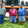 """From left: Brothers Kevin, Kurt and Kory Wilson pose near their sprayer at one of their tomato fields in Galveston on Tuesday, July 6, 2021. The brothers produce tomatoes for Red Gold, and recently won the company's """"Master Grower"""" award that's given only to a handful of farms each year that contract with the company."""