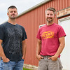 Duane Scott, 36, left, and his brother Wes, 41, pose at Oak Ridge Farms on Wednesday, June 30, 2021 in Adams Township. The two manage the farm which focuses on cattle as well as growing corn and soy beans.