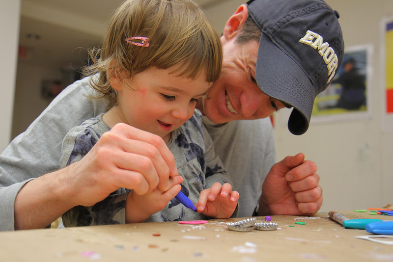 Father with Daughter in Workshop Room