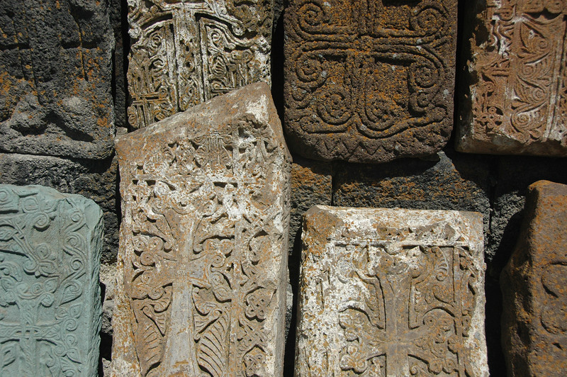 These are khachkars at the Sevan Monastery. They're intricately carved monuments that serve as memorials. Noune said the Turks claimed they were a Turkish invention, even though Turks and Armenians don't share a religion. Bad blood, there.