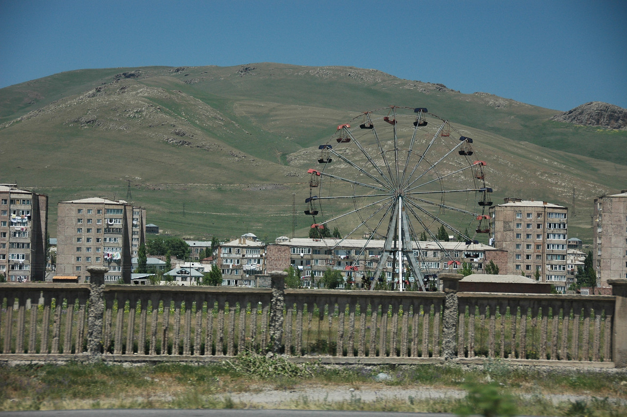 Leaving Yerevan you'll see a cloister, the zoo, a big water park with curvy slides, the statue to Saint Mesrop Mashtots, inventor of the Armenian alphabet, and the engineering and medical institutes. And this Ferris wheel.