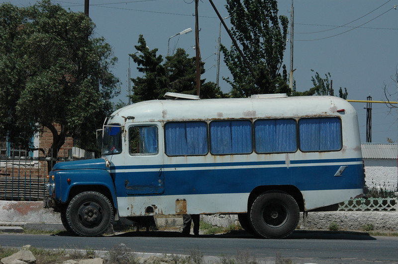 """ ... an old round bus gasped for air at the curb. It was blue and white, with blue curtains pulled completely shut in each of the four windows along the side. All the windows were surrounded with corrosion, and streaks of dried rust ran down the bus from the bottom of each window."""