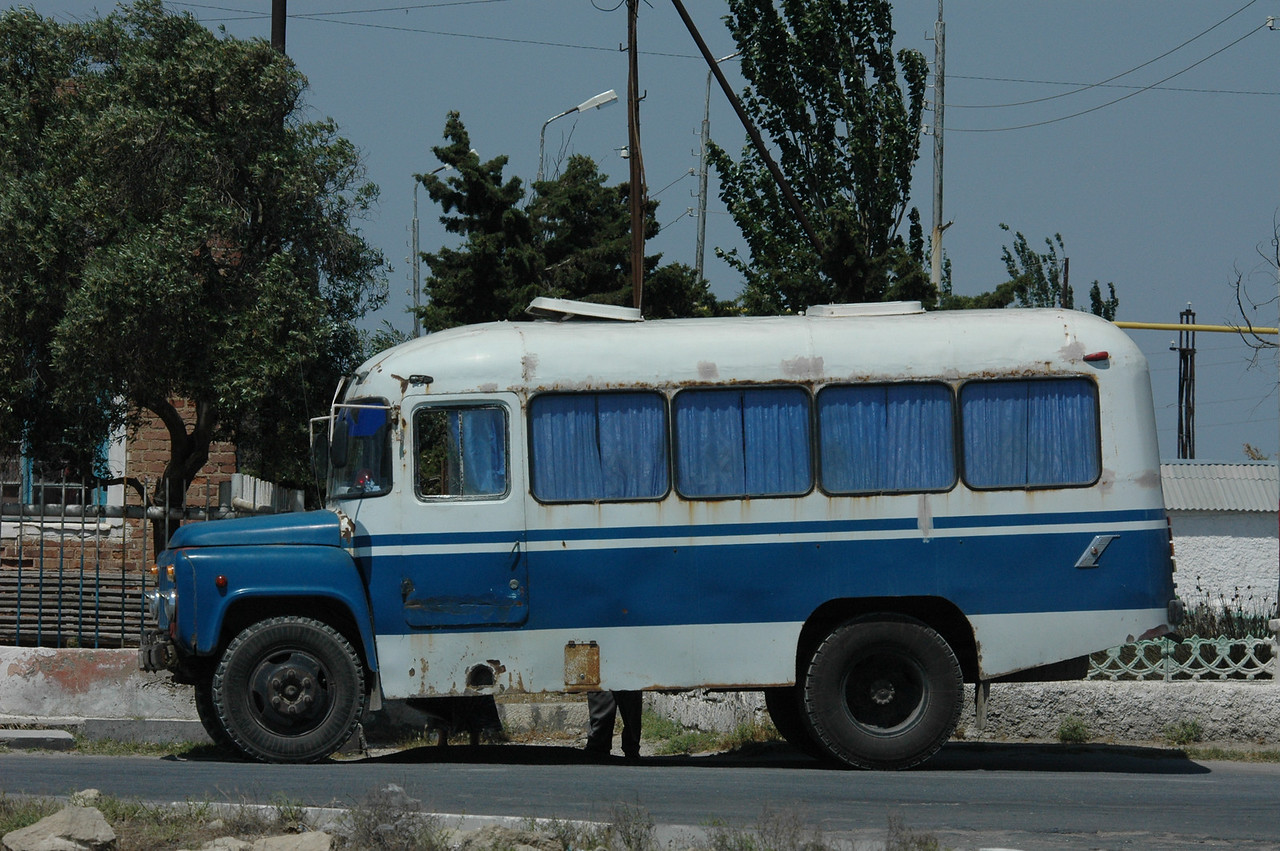 """"""" ... an old round bus gasped for air at the curb. It was blue and white, with blue curtains pulled completely shut in each of the four windows along the side. All the windows were surrounded with corrosion, and streaks of dried rust ran down the bus from the bottom of each window."""""""