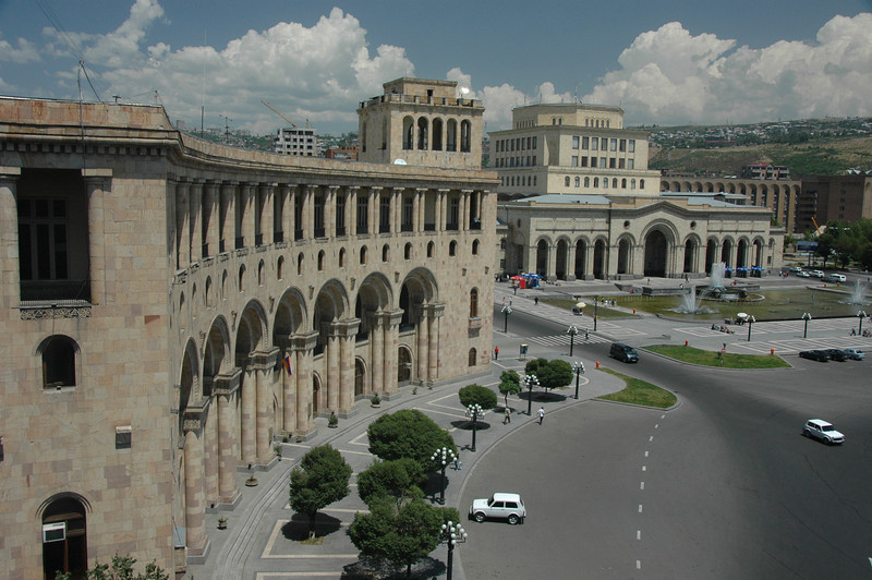 Newlyweds, preceded by a car video-taping their antics, stood through the sunroof in their limousine, as they took a few spins around Republic Square in the center of the capital. This is the Armenian Foreign Ministry, on one side of the square.