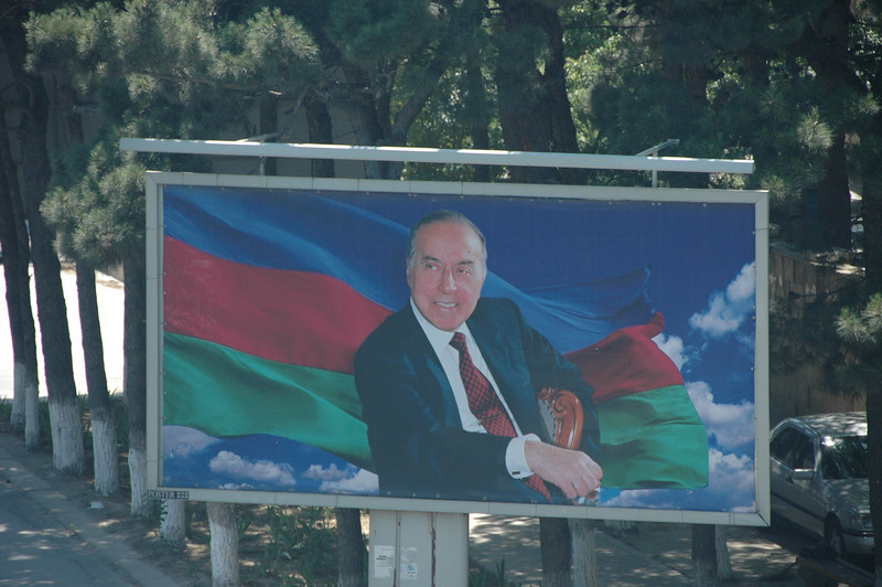 The cult of the Aliyevs, Azerbaijan. Former President Haidar Aliyev on a billboard in Baku. He was succeeded by his son.