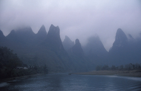 """The Li River's karst topography is famous, and similar to <a href=""""http://www.earthphotos.com/Countries/Vietnam/4251020_2Fcrz#251929200_RS77h"""">Halong Bay, Vietnam</a>. It flows through Guangxi Province, China. To sail on the Li, we flew into Guilin which, in 1995, was a whole lot different from the Chinese powerhouse we think of today."""