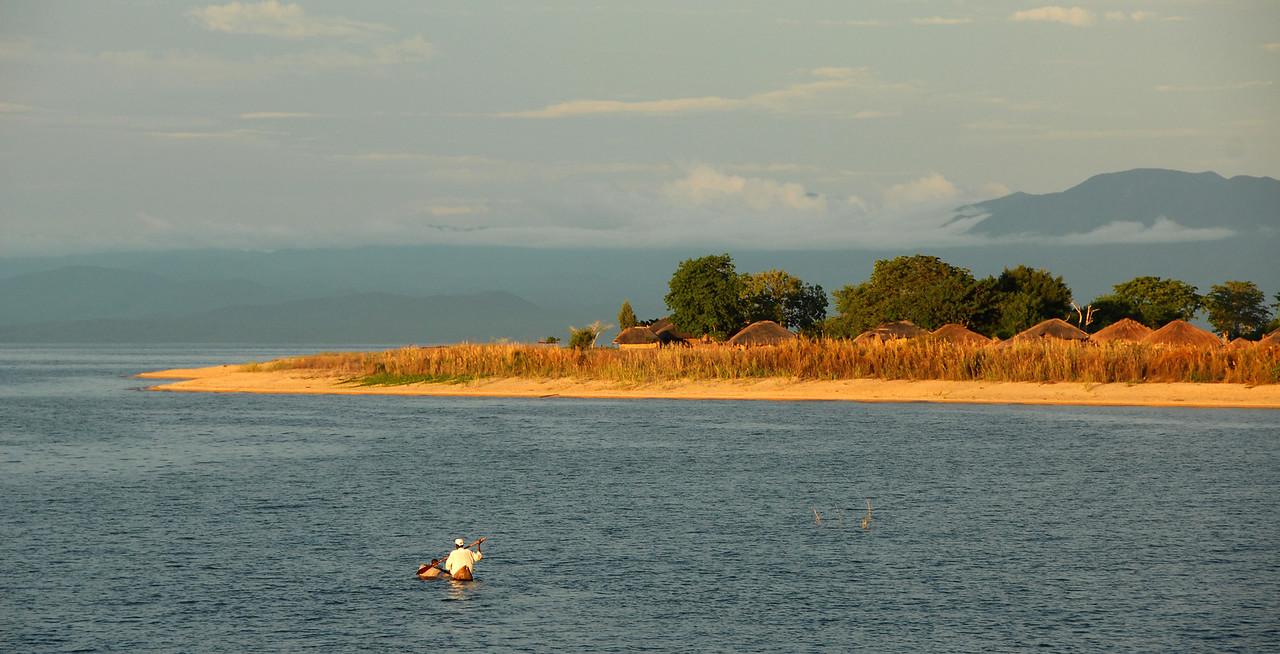 Canoe on Lake Malawi approaching Cobue village, Mozambique.