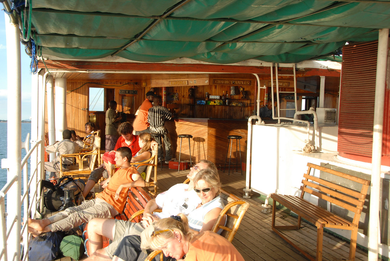 We sat up top in the first class lounge on rattan seats near the Karonga Bar, where they made an attempt to keep the beer cold. Compare upstairs...