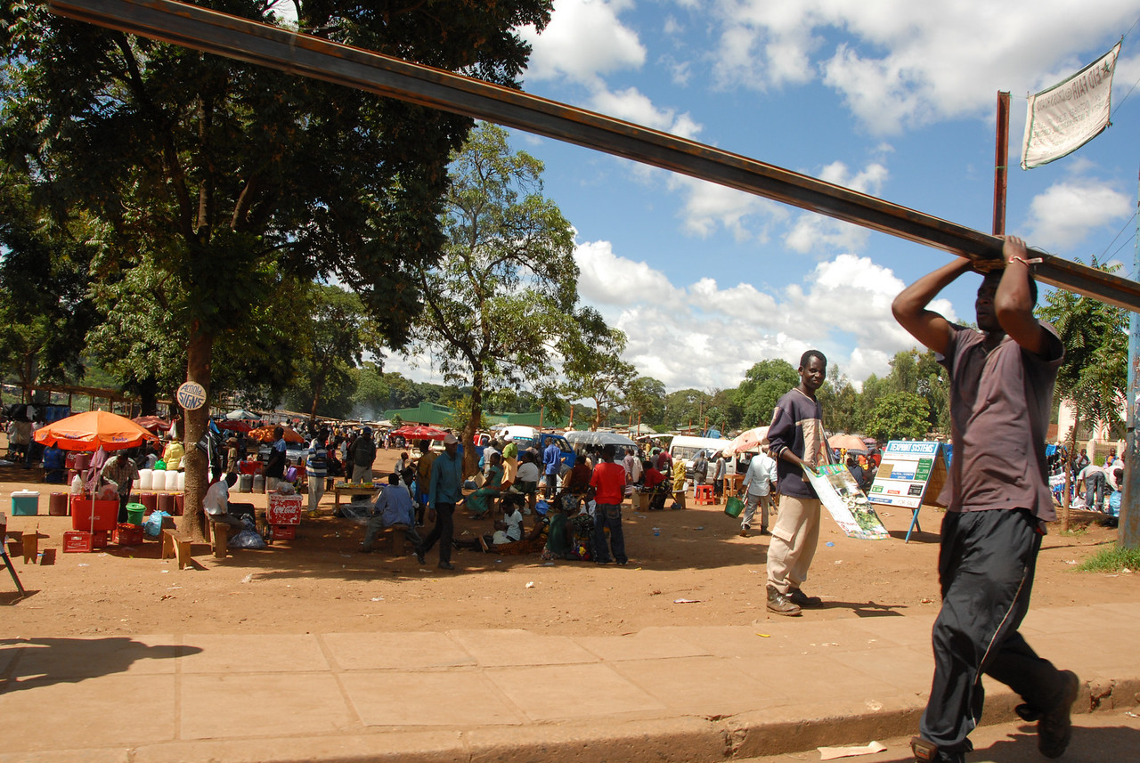 """""""Oh, I dunno, just carrying a steel beam down the street. You?"""" The central outdoor market in Lilongwe."""