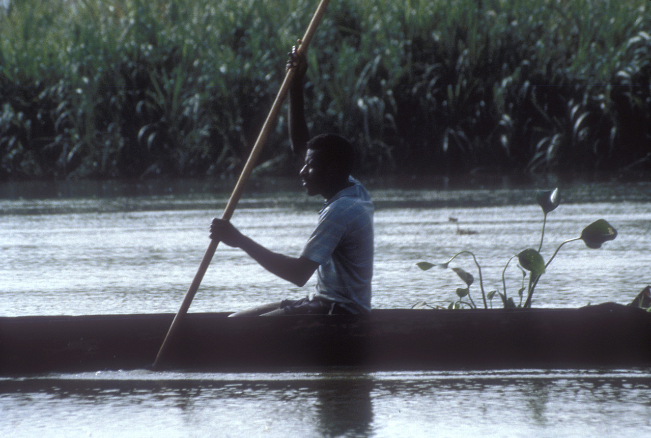 And a typical dugout canoe paddling by.