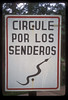 ... and snakes. The sign means there may be snakes circulating on the trails.