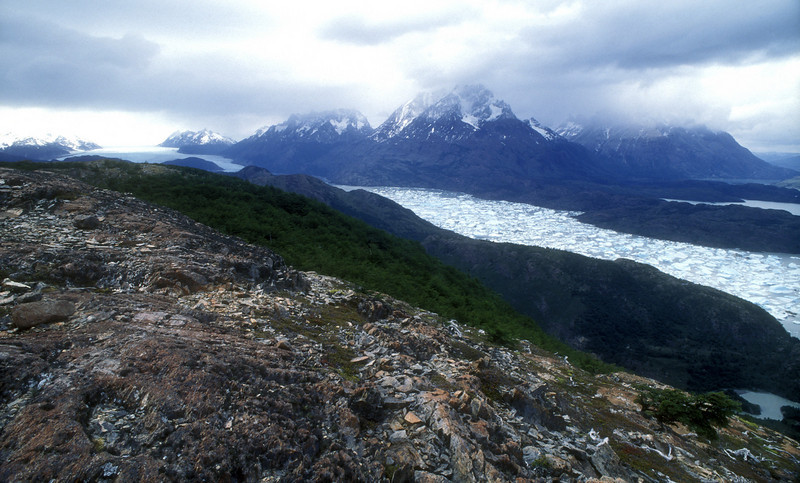 """""""Gales blew hard across barren rock at the top, with views back west to another snowy peak, and up into Lago Pingo and the glacier at its north end, closer to the Patagonian ice cap."""" Here's pack ice calved from the glacier at the top."""