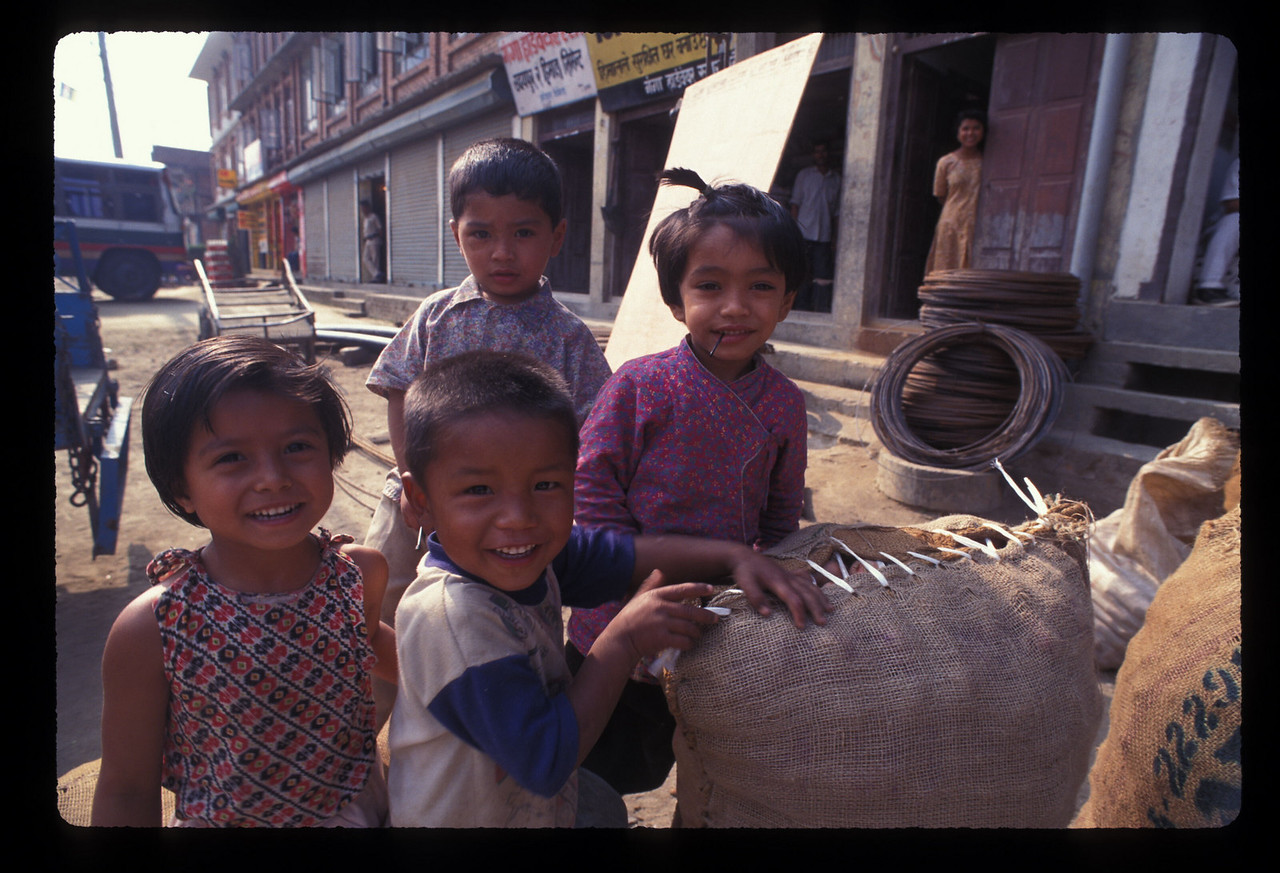 Shortly after leaving Kathmandu, Nepal for Lhasa, Tibet, we had to order up a replacement car after we couldn't find a fan belt for the first car.  We waited in the town of Banepa.The kids were cute ...