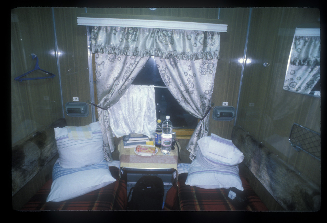 Home, sweet home. Compartment nine in carriage seven of train number two, the Rossiya, between cabin eight, with a baby, and the toilet.