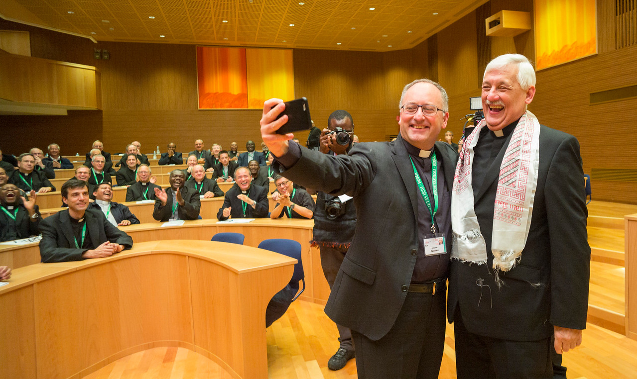 GC36 election of Fr. Arturo Sosa, of Venezuela, as Superior General of the Society of Jesus in the Aula by the Jesuits gathered from around the world.<br /> <br /> Antonio Spadaro, SJ, snaps a selfie with Arturo Sosa, SJ, the new General. Photo by Don Doll, SJ