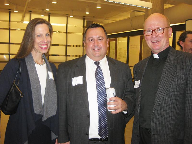 Elizabeth Kunze, Brian Amore and Bill Johnson SJ