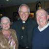 Carolyn and Paul Noelke with Fr. George Winzenburg SJ