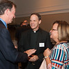 John Mehan, Fr. Tom Lawler SJ (Provincial, Wisconsin Province) and Katie Mehan (Jesuit Partnership Council of Milwaukee)