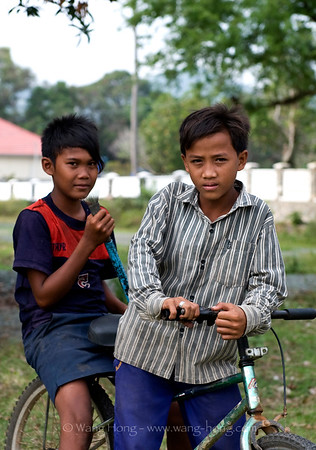 Boys outside deserted villas in Kep, Cambodia, 2010.