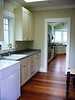 Laundry room, view to kitchen, solid pocket door between laundry & kitchen