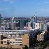 Petco Park with an airliner overhead
