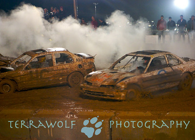 two cars highlighted against the smoke