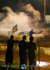 Smoke, flag, and spectators